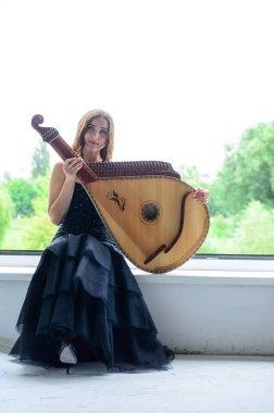 girl woman bandura musical instrument.