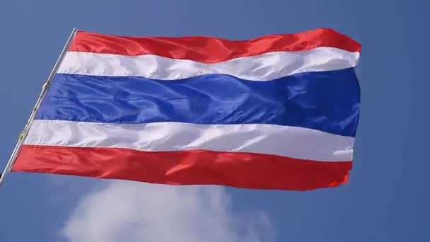 The flag of Thailand is scattered on the wind against the background of the sky