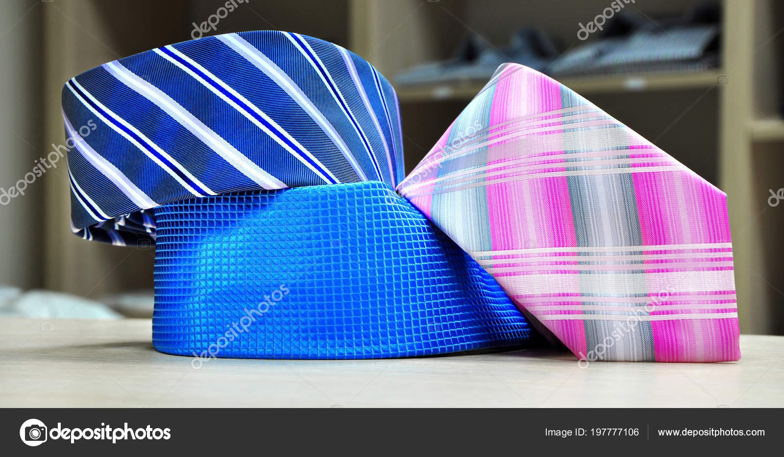 b842fd11d888 Colorful men's tie collection.Display of different patterns and colours of man  ties in a shop or showroom — Photo by Minaart