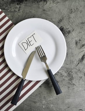 Conceptual image of diet theme. Plate with some food.