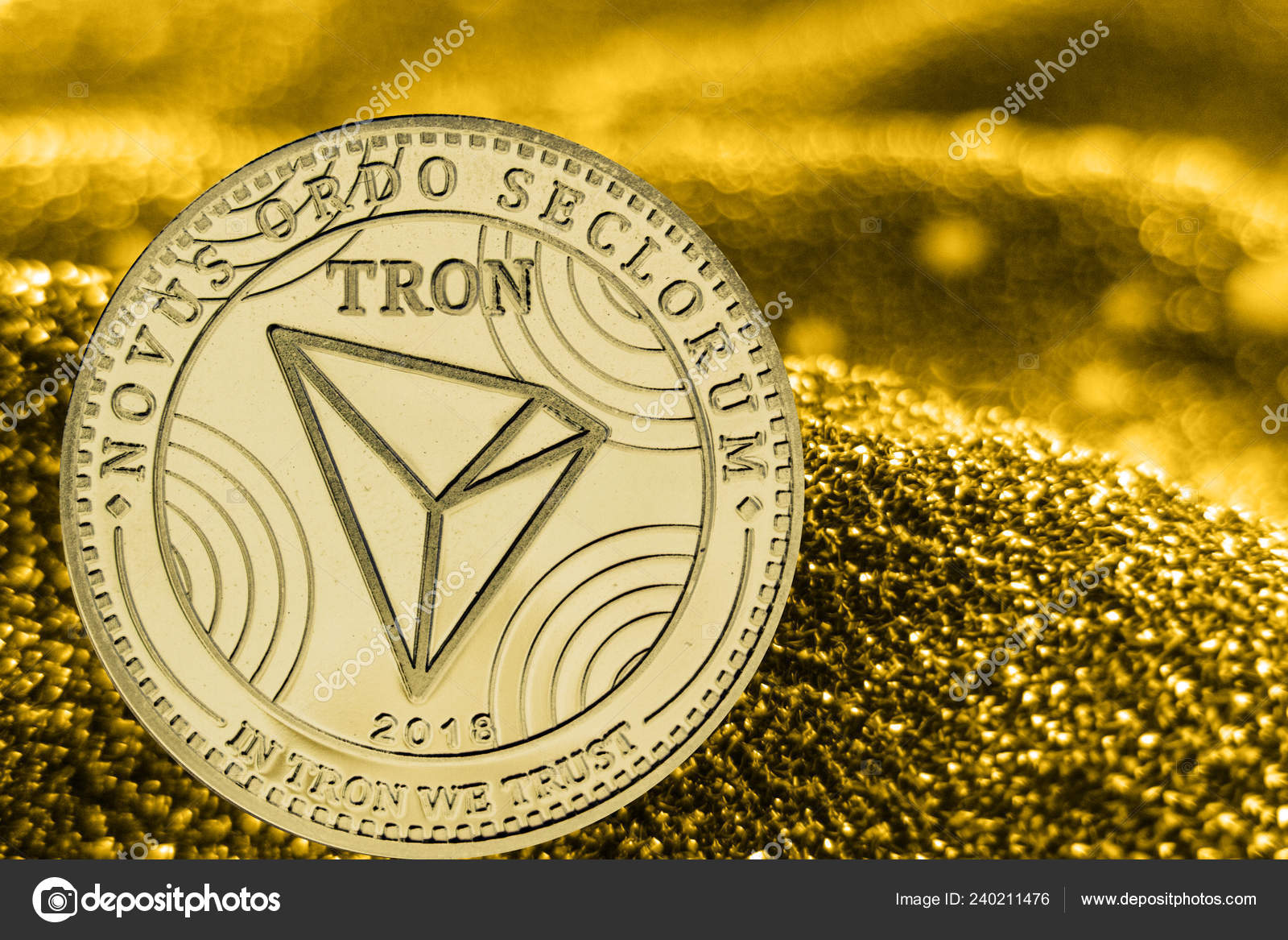 Coin cryptocurrency tron on golden background  TRX — Stock Photo