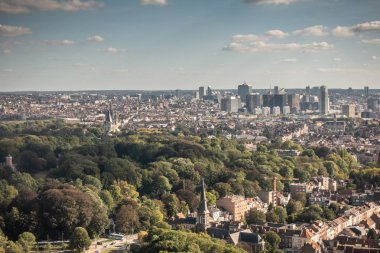 Brussels, Belgium - September 25, 2018: Highrises of North quarter and Laken Park up front seen from the Atomium highest sphere in bluish twilight sky with white clouds.