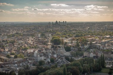 Brussels, Belgium - September 25, 2018: Basilica of Koekelberg in its agglomeration seen from the Atomium highest sphere in brownish twilight sky with white clouds.