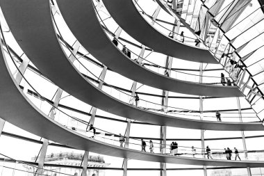 Bundestag building unique glass dome design windows, black and white tourists shadows silhouettes, Berlin travel, Germany Europe tourism.