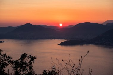 Sunset on the sea among the beautiful mountains, the Adriatic Sea. Montenegro.