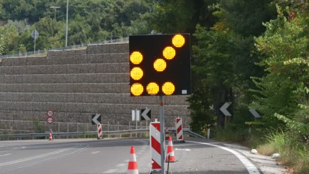 Roadworks, arrow traffic light and road signs at a road in Greece from Thessaloniki to Athens