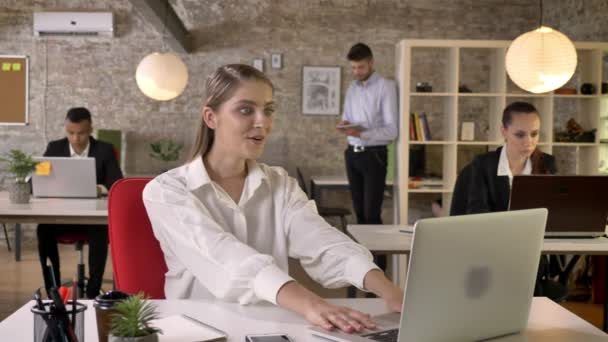 Young beautiful business woman is happy because of achievement in office, people are networking with technologies, working concept, business concept, communication concept, emotional concept
