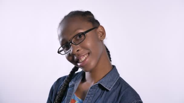 Young charming african american woman in glasses smiling at camera, isolated over white background, happy and cheerful