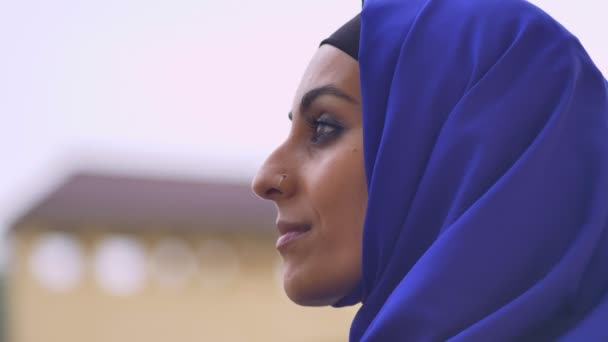 Portrait of young pretty muslim woman in hijab looking at camera, beautiful female with pierced nose
