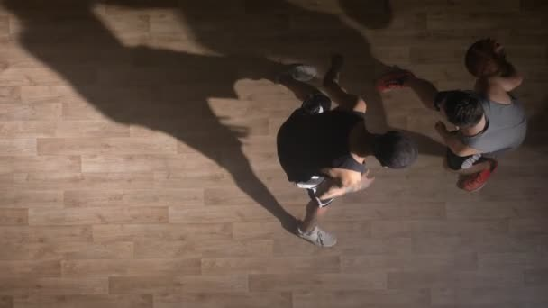 Topview, two basketball players playing one on one indoors