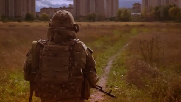 Shooting from behind, walking soldier in camouflage, is leading to skyscrapers, holding gun, crossing path, dark background, melancholic authentic illustration outdoor, isolated military man