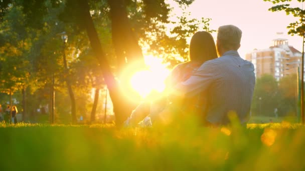 Couple of woman adn man are lovely sitting and holding each other in the park, when sun is shining their silhouettes and giving hope for future happy life, park view, modern illustration