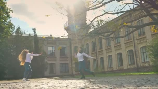 Free Dance Of Two Beautiful Caucasian Girls, Sunny Day And SUnlights on Square, Turning on Circle And Moving Dancers, Happy Vibes Near Old City Building, Public Place