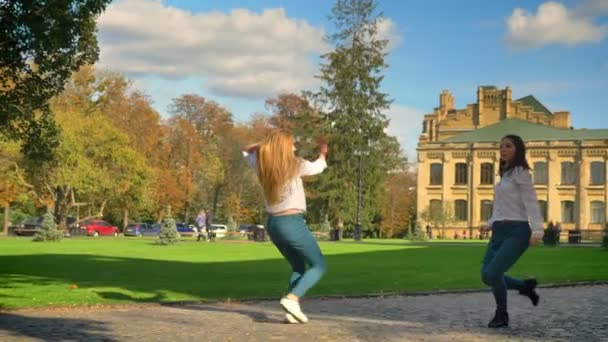 Happy Funny Caucasian Blonde Girl And Brunette female Are Dancing On Path With Ancient City On Background, Enjoyable Movements, Latin Style, Modern Illustration, Summertime