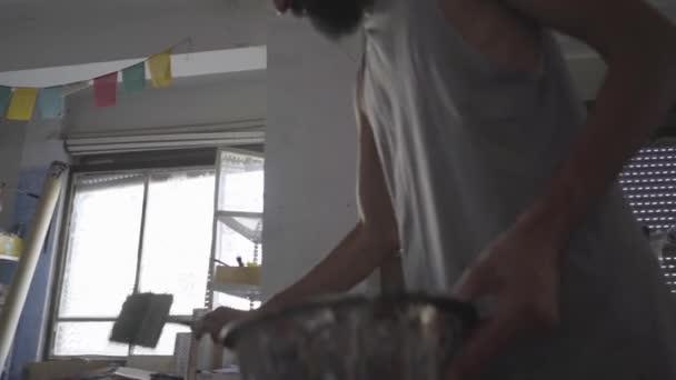 Contemporary artist working in his studio