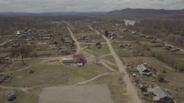 Amazing aerial view of Krasny Yar village, Russia. Krasny Yar is the capital of the Primorsky Udege - indigenous small peoples of the far north. The village stands on the river Bikin, the tributary of the great Amur. In the village works the Bikin