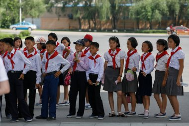 July, 2018, Pyongyang, North Korea - North Korean pioneers, boys and girls, stand in line at the Museum of Military Glory