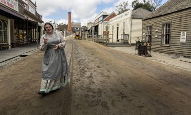 A lady in traditional costume in Sovereign Hill, an open air museum in Golden Point, a suburb of Ballarat, Victoria, Australia. Sovereign Hill depicts Ballarat's first ten years after the discovery of gold there in 1851.