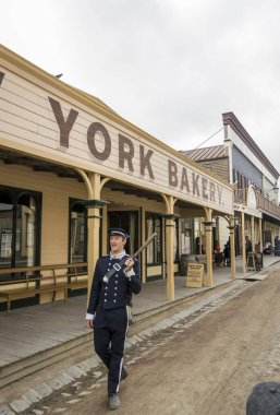 A man in traditional uniform in Sovereign Hill, an open air museum in Golden Point, a suburb of Ballarat, Victoria, Australia. Sovereign Hill depicts Ballarat's first ten years after the discovery of gold there in 1851.
