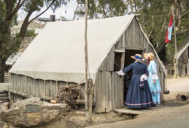 Ladies in traditional costume in Sovereign Hill, an open air museum in Golden Point, a suburb of Ballarat, Victoria, Australia. Sovereign Hill depicts Ballarat's first ten years after the discovery of gold there in 1851.
