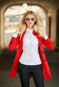 Street fashion portrait of stylish woman in sunglasses