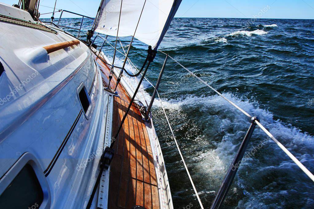Sail boat gliding in open sea