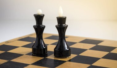 Chess. Black King and Queen on the board .The most powerful figures.