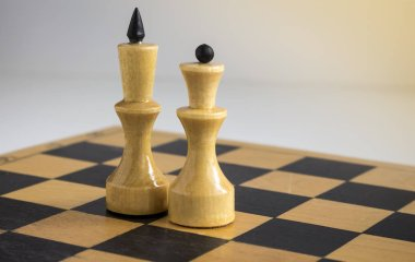 white king and Queen on the chessboard