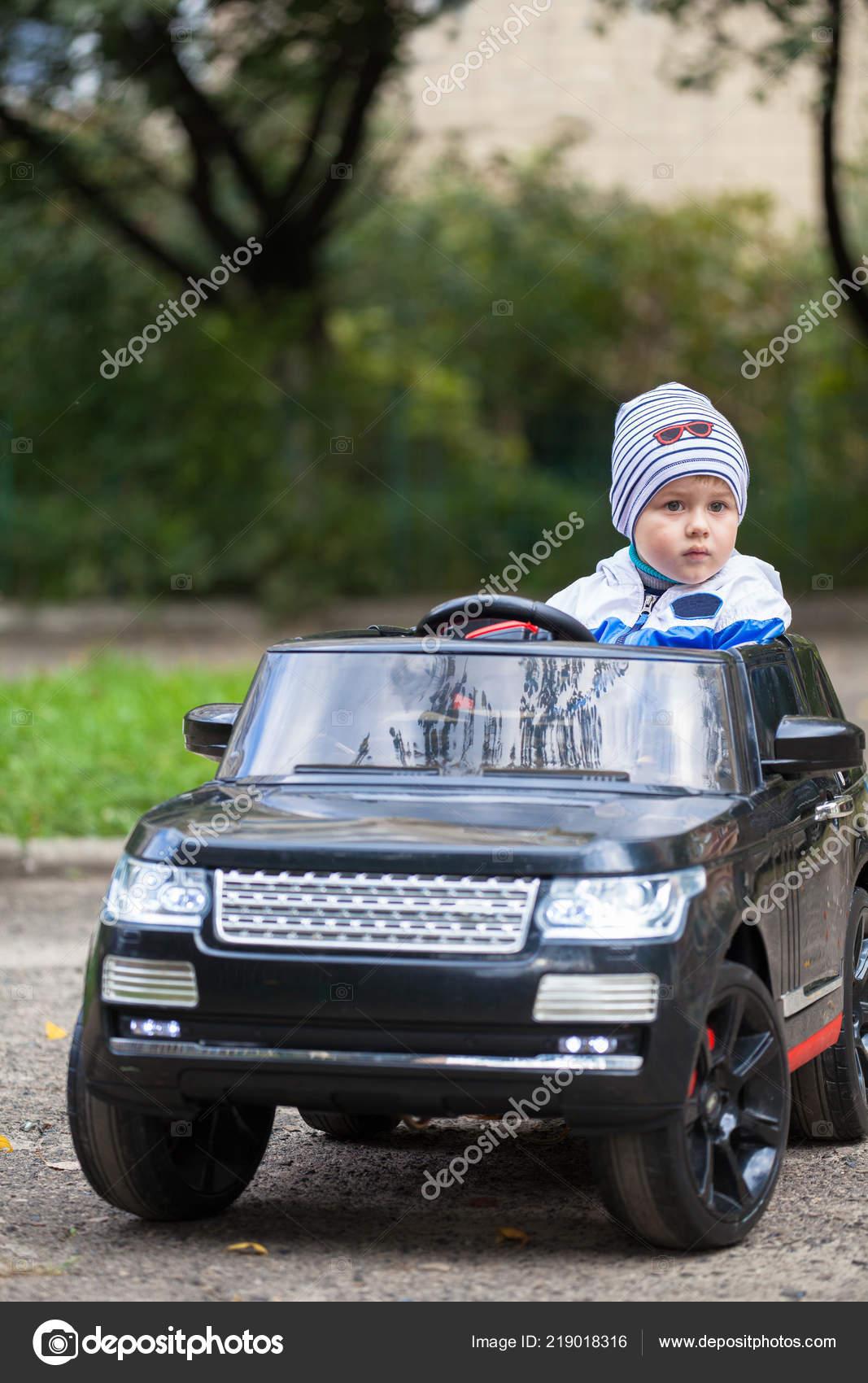 Cute Boy Riding Black Electric Car Park Funny Boy Rides Stock Photo C Vasyl Rohan 219018316