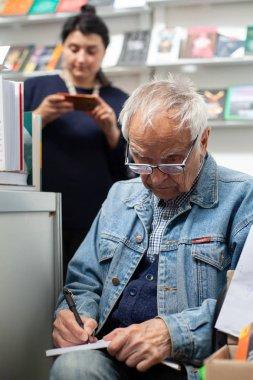 LVIV, UKRAINE - SEPTEMBER 20, 2019: autograph session of Dmytro Pavlychko at the 26th Lviv International Book Fair.