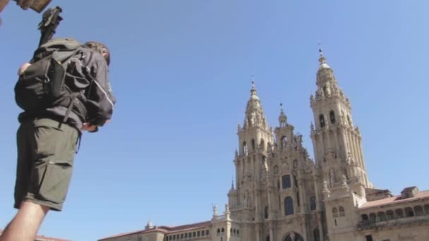 PILGRIM PHOTOGRAPHING THE CATHEDRAL OF SANTIAGO DE COMPOSTELA