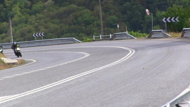 TWO MOTORISTS TAKING THE CURVE