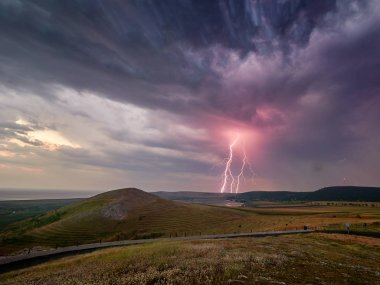 Thunderstorm with lightnings over the fields, long exposure image