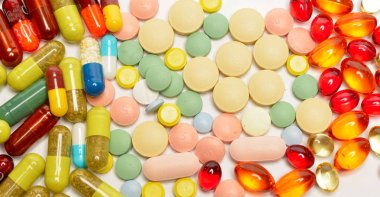 various colorful pills isolated on white