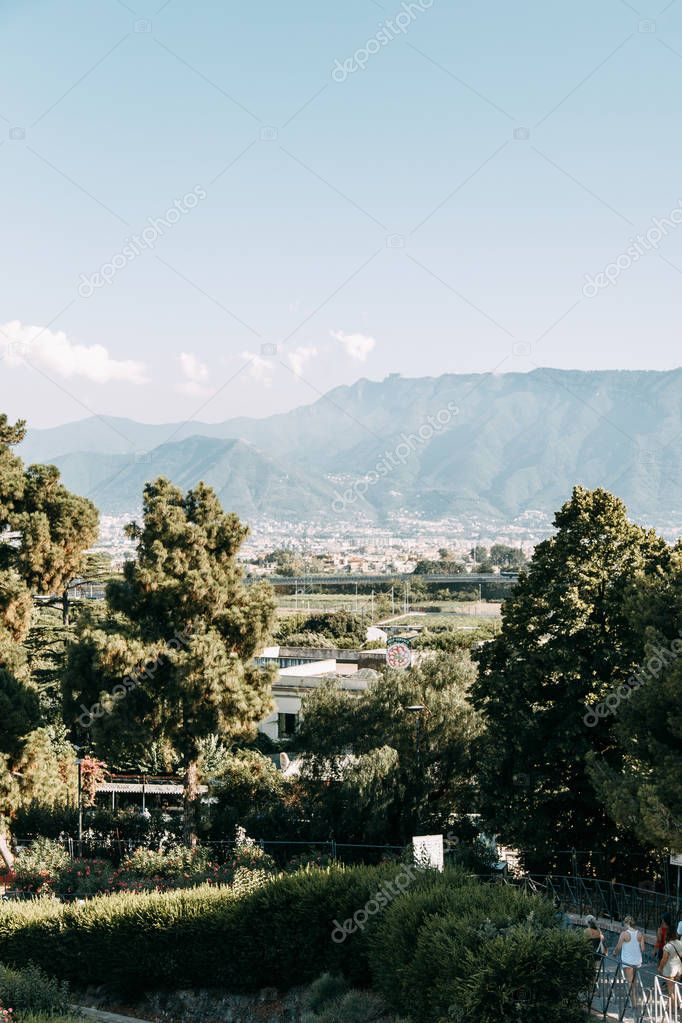 Destroyed ancient ruins of Pompeii. historical ruins with views on mount Vesuvius, Italy. Fossils and excavations, panoramic view of the city. Attractions and world heritage.