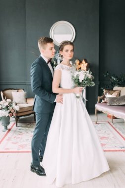 Beautiful couple in the Studio standing and dancing. Wedding in the European style fine art.