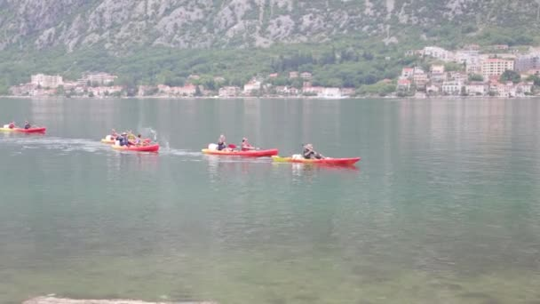 Rowers kayaking in the Bay of Kotor. Competition and tourist holidays in Montenegro.