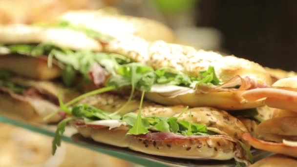 sandwiches with greens and ham. Italian bruschetta on the counter.