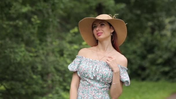 Sunny photo shoot on. Girl in a hat walking in the summer Park.