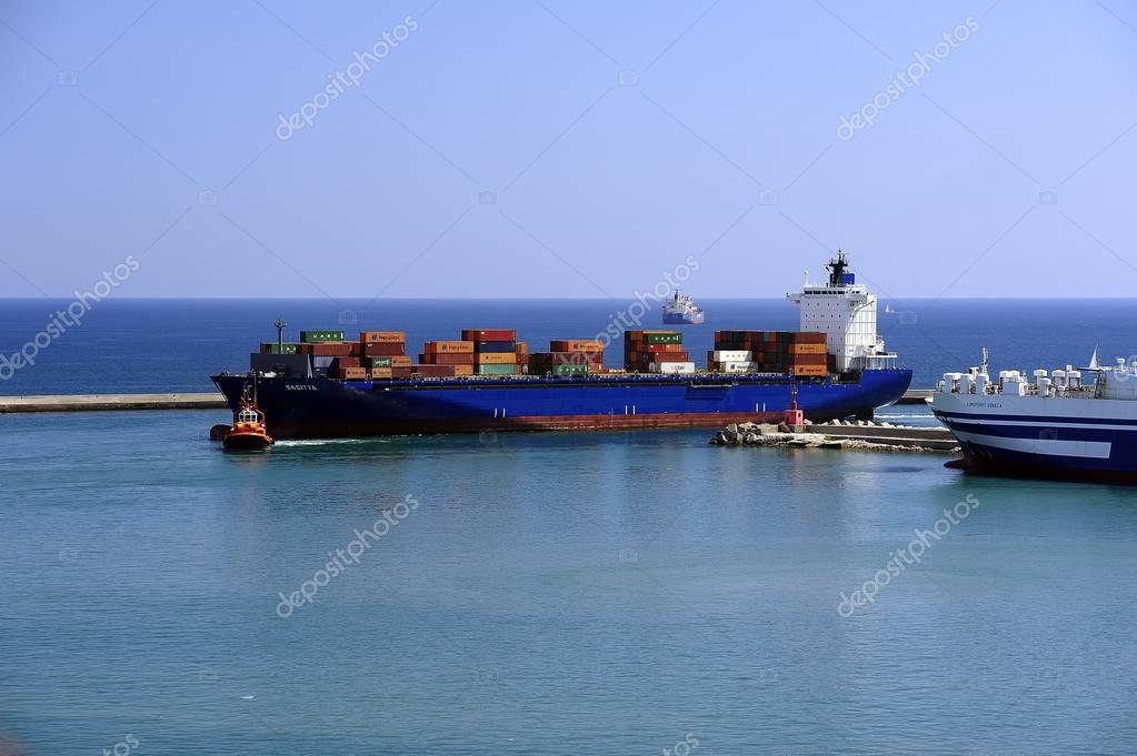Sagitta, Port of Salerno, Italy - July 2018: Sagitta entering the Port of Salerno under a tug