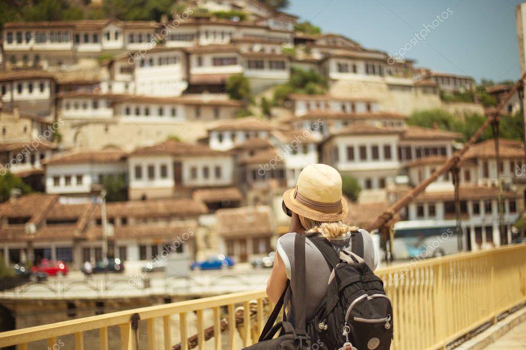 BERAT, ALBANIA - June 2018: Photographer tourist taking picture of old town Berat, Albania, Unesco World Heritage Site.