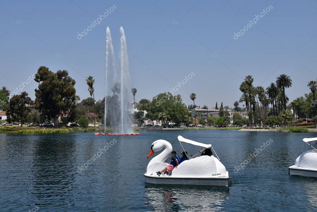 People enjoying the paddle boats in the lake at Echo Park in Los Angeles.  Exclusive, royalty free Los Angeles Stock Photos.  Editorial uses only