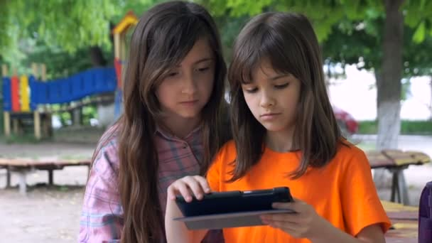 Two Girls are Using Tablet