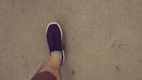 Feet walking on the street