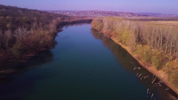 Slow drone flight over blue river and agricultural lands. Dniester river, Moldova republic of. 4K birds eye view