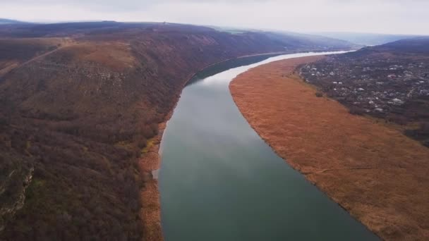 Drone flight over blue river and agricultural lands. Dniester river, Moldova republic of. 4K birds eye view