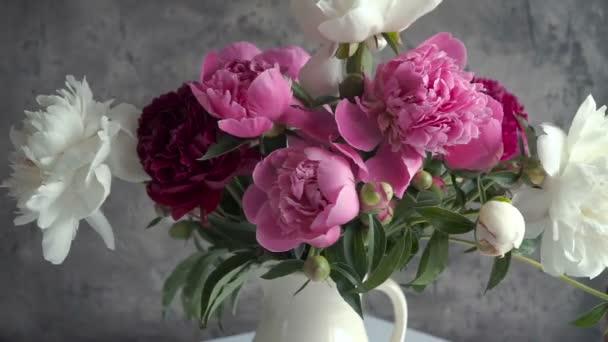 Bouquet of colored peony in vase. Fresh garden peonies.
