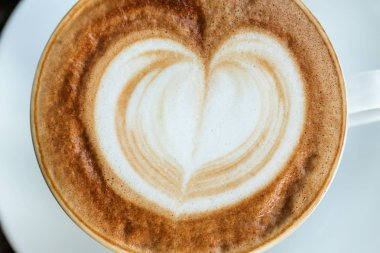 Cup of cappuccino with foam in the form of heart
