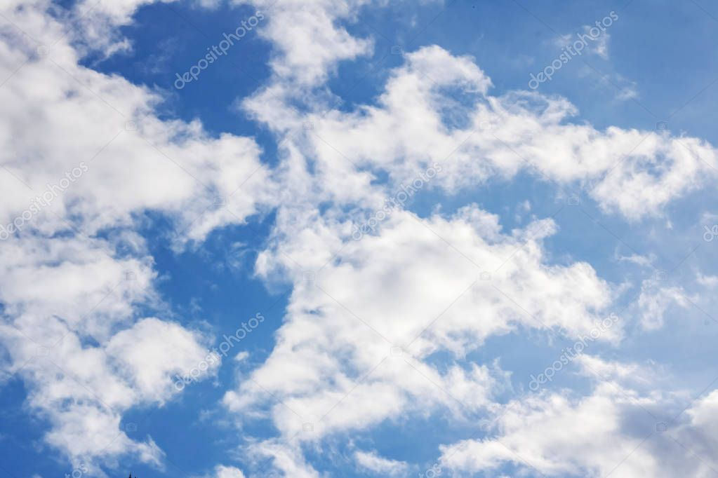 White clouds and blue sky background or texture