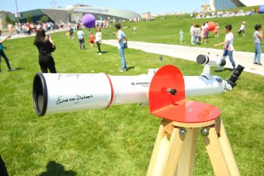 BAKU, AZERBAIJAN - JUNE 1 2019 : Kids festival . In park of Heydar Aliyev Center. BRESSER Messier AR-90 900 NANO AZ Telescope